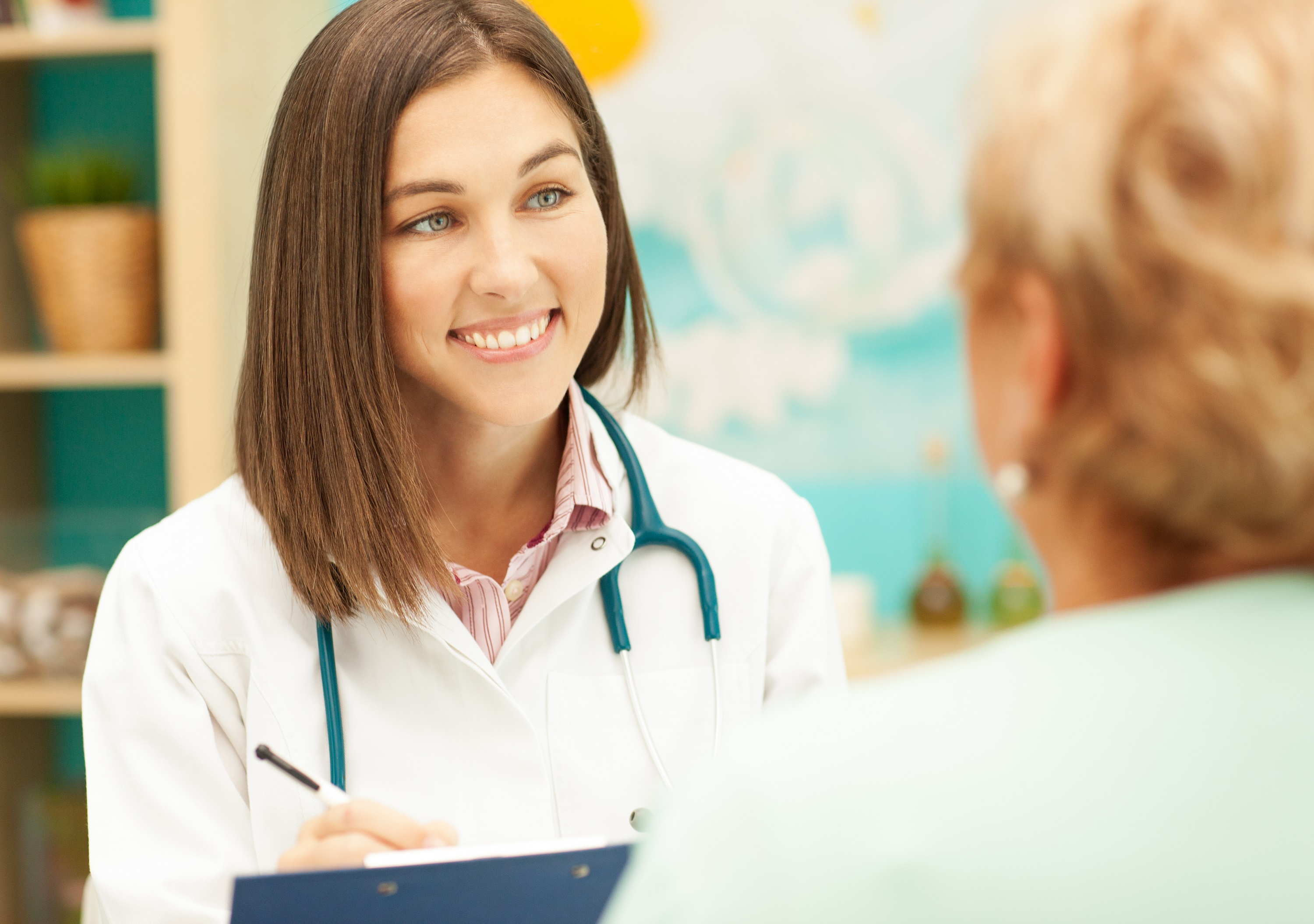 Smiling doctor talking to her patient.